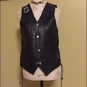 Vintage Manzoor black leather biker jacket.